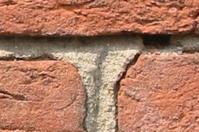 Three_old_bricks_held_together_with_mortar